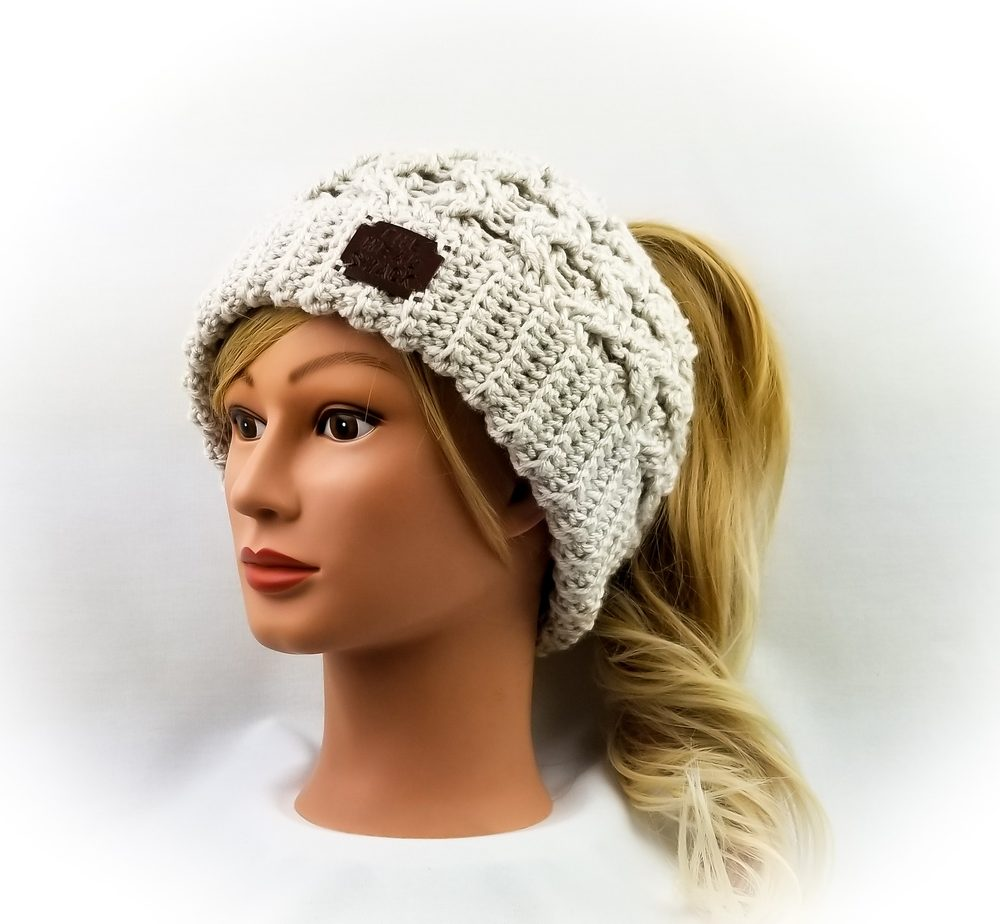 linen colored cabled messy bun hat